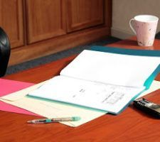 Board room table with files and a cup of coffee